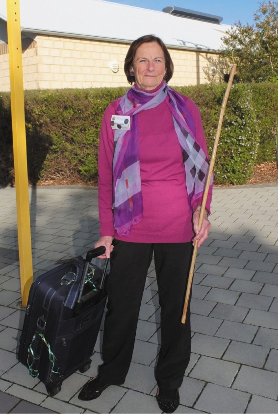 Cancer survivor and senior storyteller Val Corey  outside a local primary school with her cane.