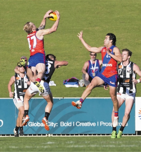 West Perth's Kody Manning flies high for a mark.