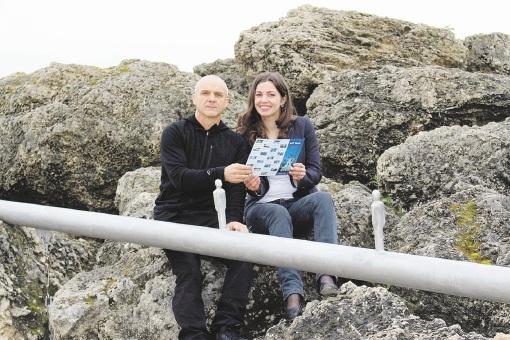 Mandurah Art Gallery curator Gary Aitken and Nadine Heinen with a trails brochure.