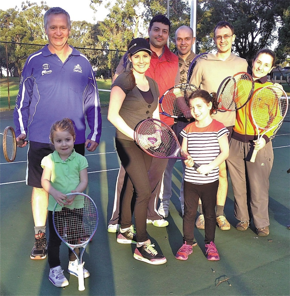 John Logan (in blue jacket) with residents at the Penistone Park tennis courts.