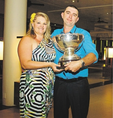 Gary and Helen Sims with their award.