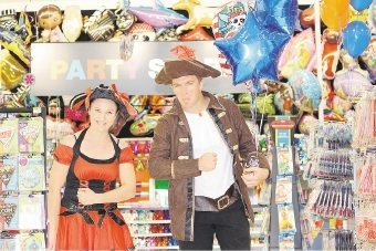 Store assistants Kirstie Hunt and Chris Cole ham it up in the new party section