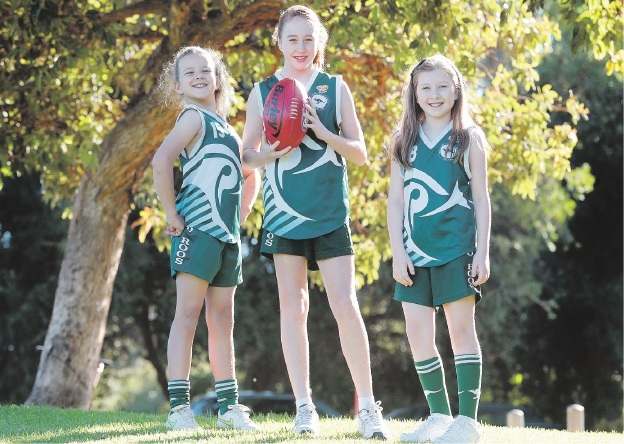 Charlotte Brown (10), Eve Miller (13) and Kate Fabling (10) from Riverton Junior Football Club.