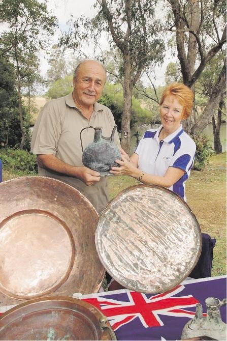 Demir Bükey presents a copper jug from Gallipoli to Blue Gum Park Tennis Club president Pauline Foster.