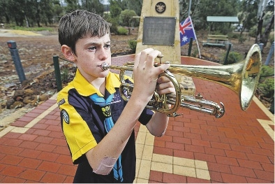 Trumpeter Jordan Egan (10) sounded Last Post at an Anzac service in Bakers Hill yesterday morning. Picture: Bruce Hunt www.communitypix.com.au   d435924