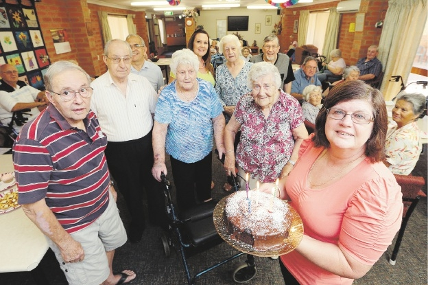 Residents celebrate with a cake, held by staff member Irene Bentink.  Picture: Marcelo Palacios d434633