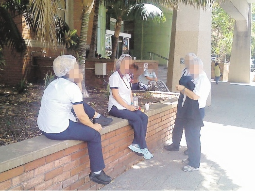 Staff smoking outside Royal Perth Hospital. Pictures: Phill Moncrieff