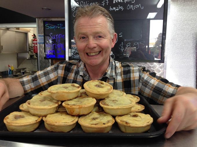 Douglas Hutton with Scottish pies he made for the cafe. Picture: Justin Bianchini