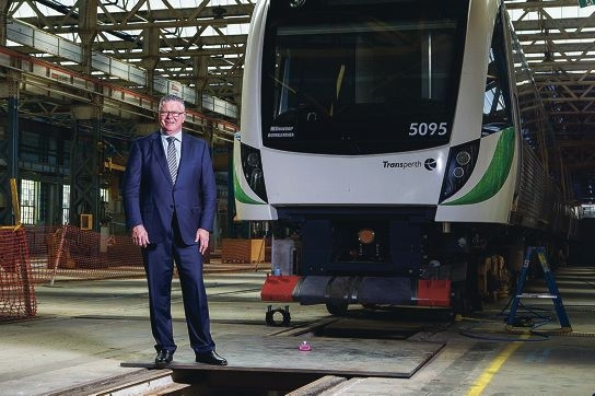 Transport Minister Troy Buswell with the first of the three-car configuration trains at Midland Railway Workshops. The new trains will operate on the Clarkson and Mandurah lines.