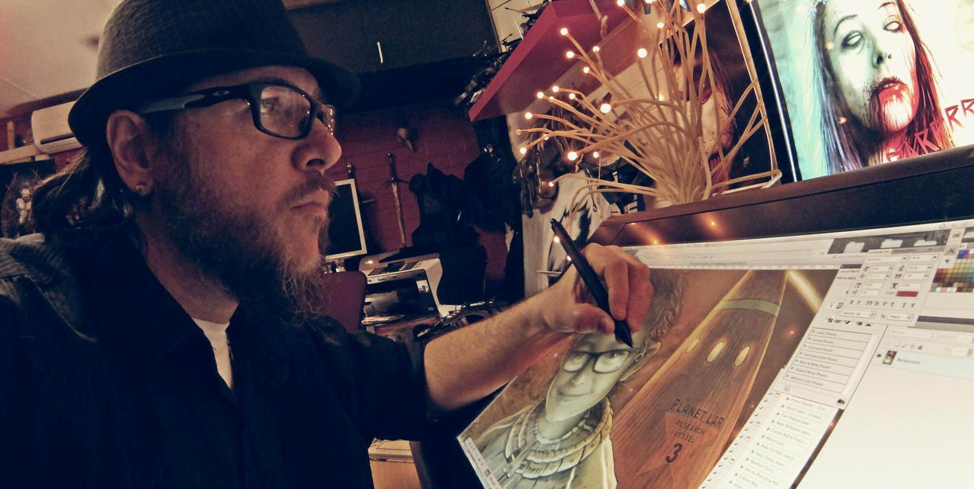 Comic book artist and graphic design lecturer Justin Randall working in his home studio.