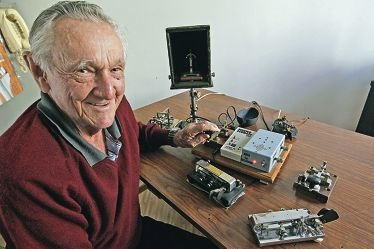 Richie Bright at home with the apparatus he uses for morse code messages.