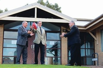 Member for Riverton Mike Nahan intercepts a handpass from City of Canning Commissioner Linton Reynolds to Sports Minister Terry Waldron.