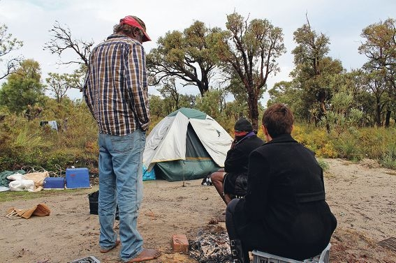Aboriginal Liaison Officer Lisa Fieldhouse with homeless people at the Mirrabooka site. Picture: Tom Rabe