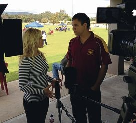 Amateur Footy Time presenter Frizz Ferguson interviews a player from Maddington Football Club.