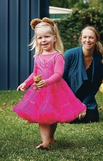 Renee Whitcher with her daughter Isabella (2) in their backyard.