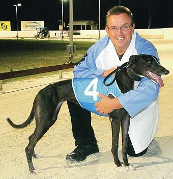 Kennel foreman Chris Halse with Saving Bundles, which had a big win in the Free To All over 490m.