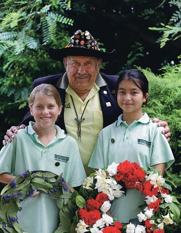 John Schnaars, president Honouring Aboriginal War Graves Inc, with head boy James Beardsell and head girl Samantha Alibang