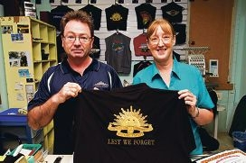 Francis Lane with Glenda Berry of West Coats, with the embroidered ANZAC shirts.
