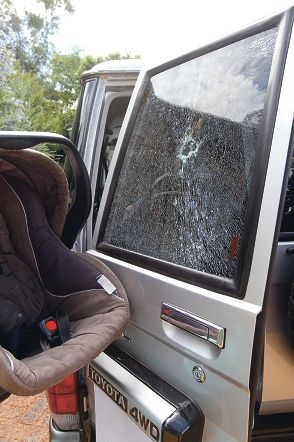 The smashed car window and the seat the baby was in. Picture: Bruce Hunt www.communitypix.com.au d399128