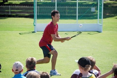 Five-time IHF World Hockey Player of the Year Jamie Dwyer demonstrates skills to students at the clinic.