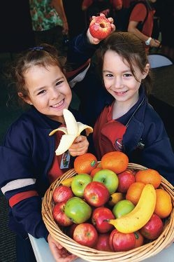 Breakfast that packs a punch: Charlotte Adams and Charlie Richmann with a basketful of fruits. Picture: Marcelo Palacios d397543