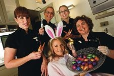 Signature Dental staff Janic Cordony, Marianne Tooley, Margaret Allsop and Allison Kale with Easter bunny Holly Wards. Picture: Matthew Poon d398274