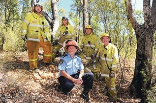 David King (foreground centre) with Parkerville Bush Fire Brigade volunteers, from left, Greg Walsh, Chris Caudwell, fire control officer Magnus Ohman and Lieutenant Peter Weis. Picture: Marcus Whisson www.communitypix.com.au d397532