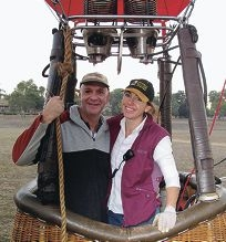 Main picture: The hot air balloon Twirl flies across the Avon Valley. Inset: Donna and Michael Tasker