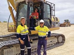 Polytechnic West trainers Bob Ragg (right) and Karen Sloan with a |student trainee on the job.