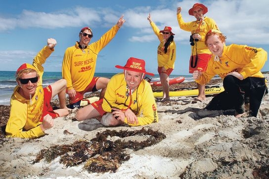 With seaweed symbolising 30 years of beach patrols, club president Chris Papaioannou (centre) celebrates with other patrol members. Picture: Robin Kornet d387900