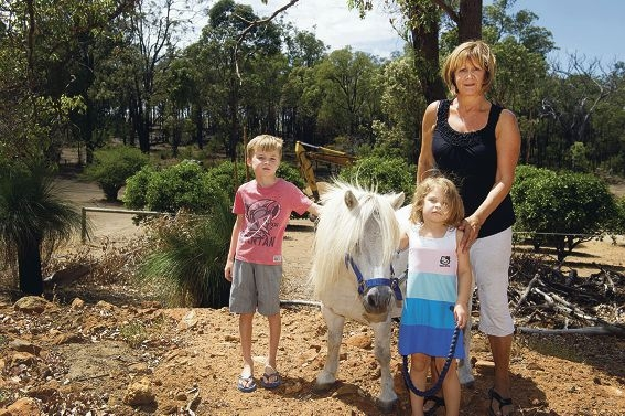Judy Watters with her grandchildren Jake (6 ) and Indiana (4) and Roxy the pony are relieved the bushfire narrowly missed her property. Picture: Emma Reeves www.communitypix.com.au d396670