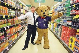 Mandurah Forum Woolworths manager Darren Dews with Stitches the Bear.