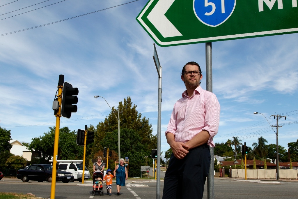 Bayswater councillor Dan Bull at the busy intersection, while Andrea Chivers and her children Brodie (4) and Lachie (20 months) and her mother Margaret cross at the intersection. Picture: Marie Nirme