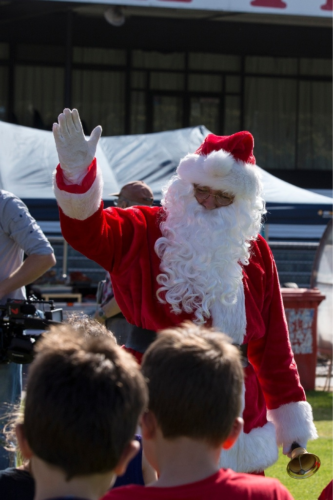 Santa adds sparkle to  footy party for juniors