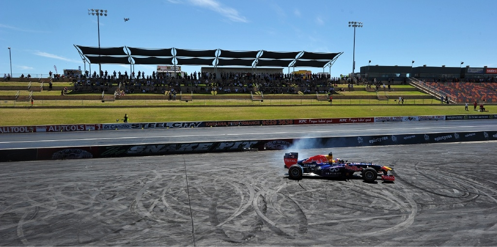 Daniel Ricciardo behind the wheel and burning rubber at Perth Speedfest. Pictures: Jon Hewson