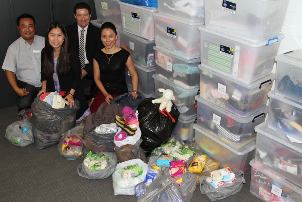 Eh Soe Kyat Oo, Daffodil Sawmei, Paul Rafferty and Elizabeth Scully with the donations for pending Syrian refugees. Picture: Lauren Pilat