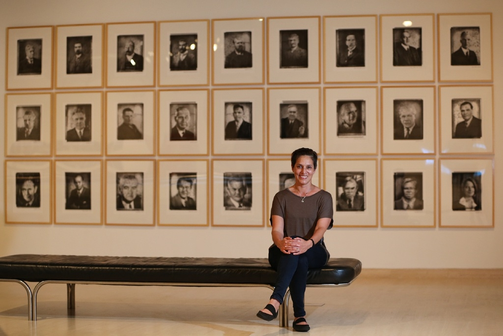 AGWA Aboriginal and Torres Strait Islander art curator Carly Lane with Michael Cook's Through My Eyes. Picture: Andrew Ritchie d446286