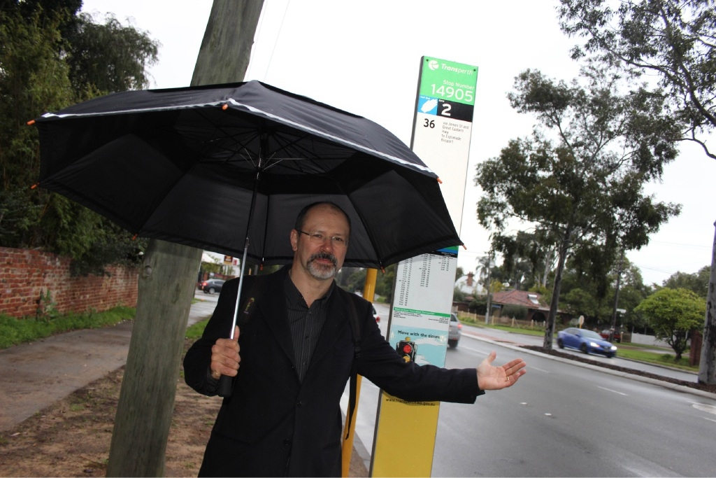 Ian Johnson, who was photographed last year during his campaign to save Guildford's historic bus shelters, voted against later meeting times despite his pre-election pledge.