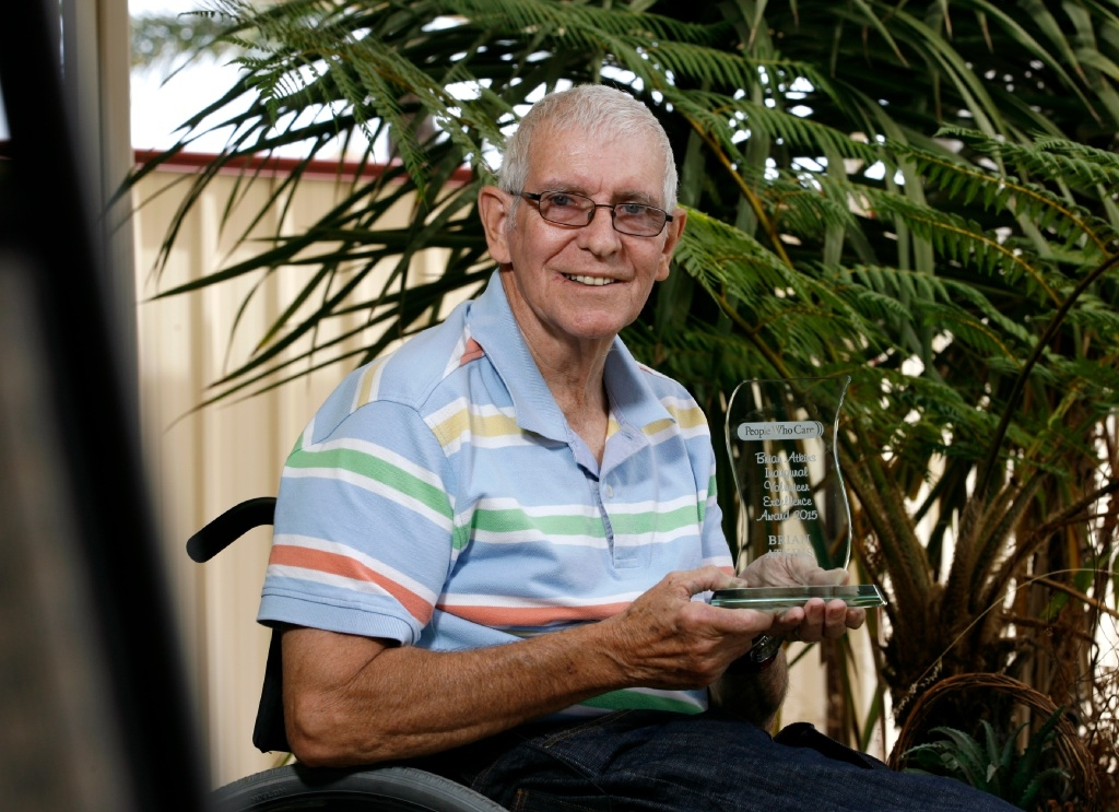 Brian Atkins is the first person to receive a perpetual trophy from People Who Care.  Picture: Marie Nirme        d445947