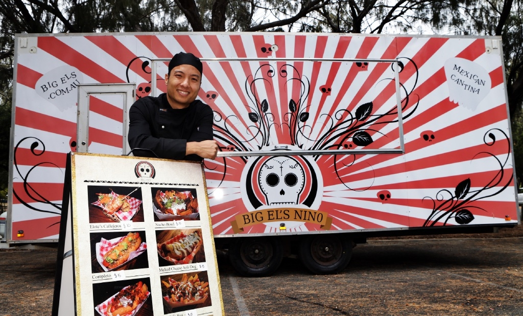 Logan Punyanitya gets set up for the outdoor food market. Picture: Martin Kennealey                         www.communitypix.com.au   d445673