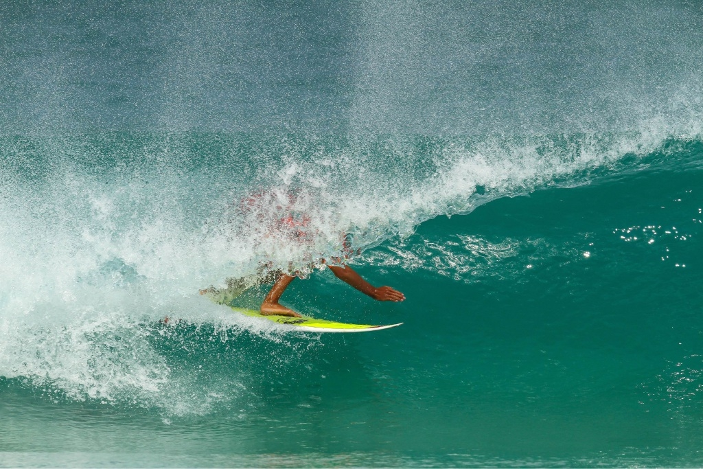 Bicton's Alex McGuffin slips into a barrel during the GromSearch. Picture: Nick Woolacott