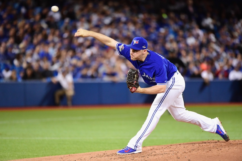 Liam Hendriks pitches during the MLB playoffs.