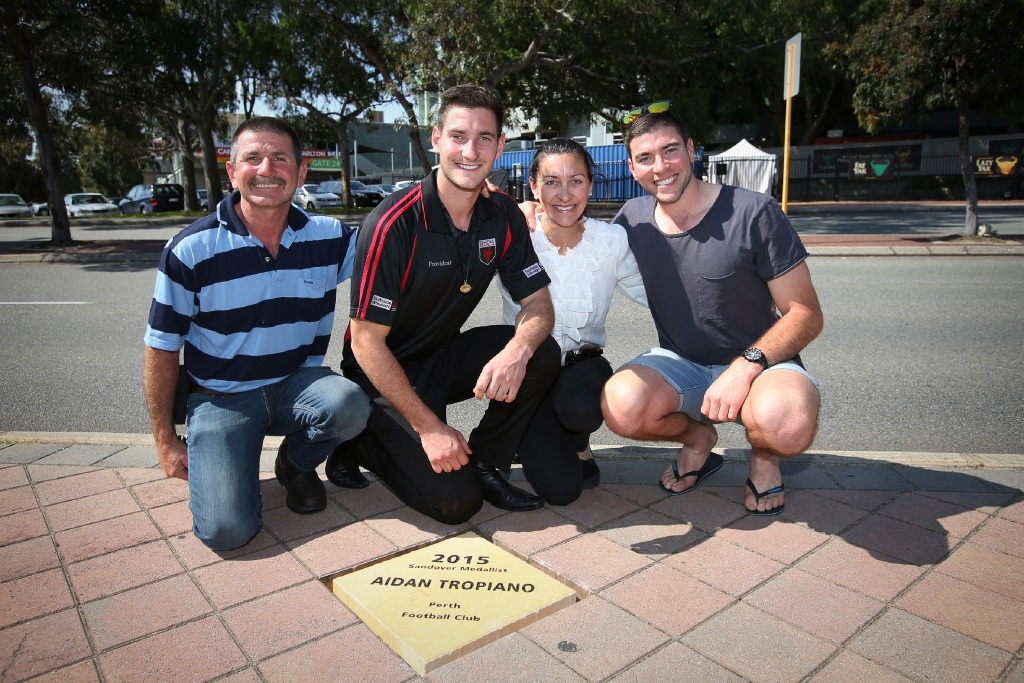 Tony, Aiden, Anita and Kurt Tropiano at the plaque that commemorates Aiden's Sandover Medal win.