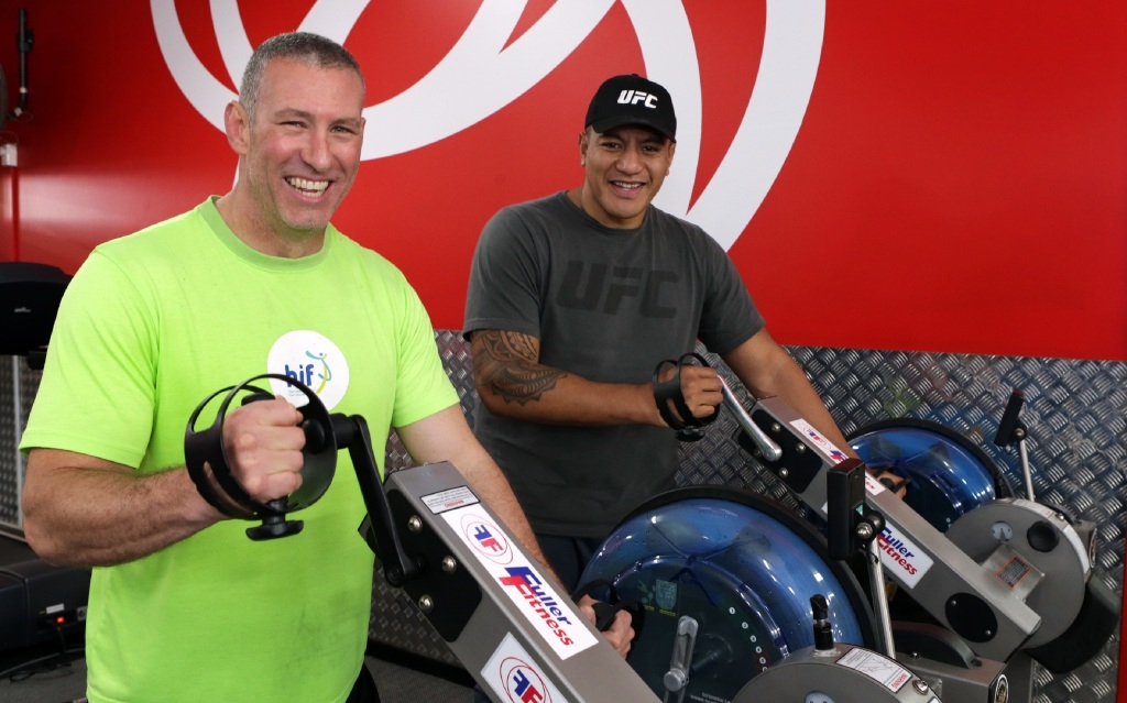 Not a grind for Telethon: Former rugby league player Matt Fuller and UFC fighter Soa Palelei on the ergo grinder. Picture: Martin Kennealey www.communitypix.com.au   d443518