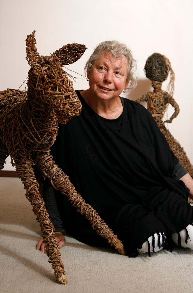 Artist Janine McAulley Bott with some of her woven art pieces. Picture: Marie Nirme                   communitypix.com.au   d444081