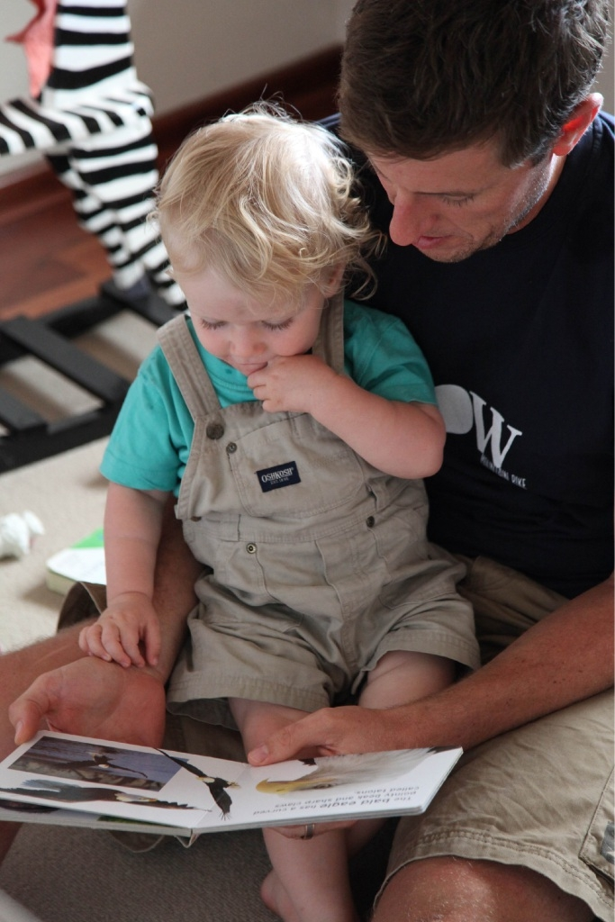 Brad Smith reads to son Oliver as part of Ngala's Dad WA program.
