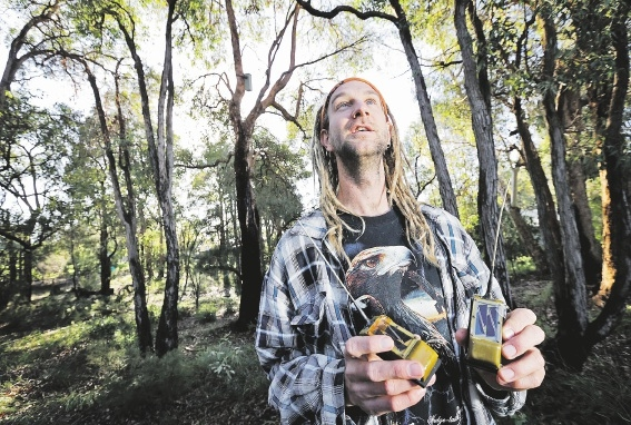 Ornithologist Simon Cherriman tracks birds using a GPS transmitter and (inset) one of the dead chicks.Picture: David Baylis         www.communitypix.com.au   d440293