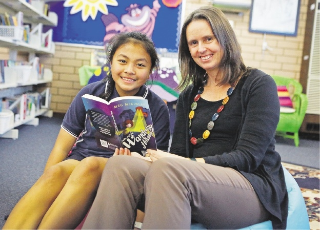 Year 6 student Charmagne Salas with author Meg McKinlay.Picture: Matt Jelonek        www.communitypix.com.au   d442703