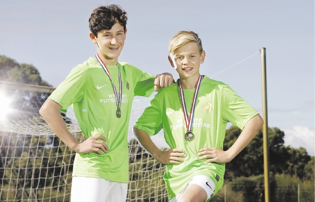 Year 8 students Alessandro de Andrade Basto and Lewis Collier were members of the Australian under-13 team that won the World Futsal championships recently.  Picture: Marie Nirme    d442407