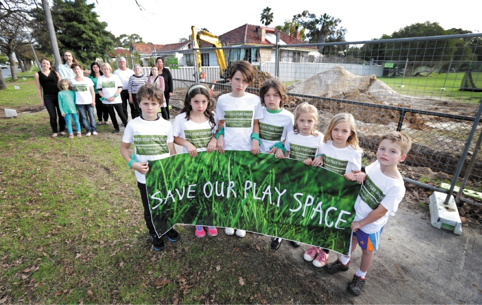 Front, from left: Lucy Coates, Elise Kasdorf and Joyce Tasma, with other Save Our Play Space supporters |behind them. Picture: David Baylis    d442651